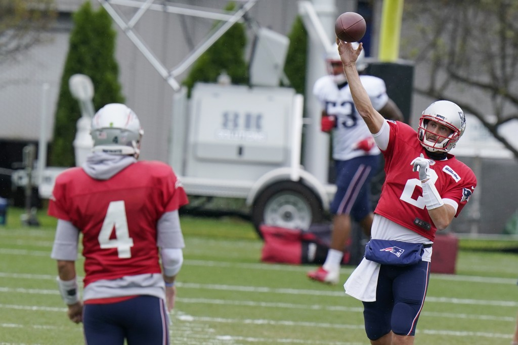 New England Patriots quarterback Brian Hoyer (2) throws to quarterback Jarrett Stidham (4) during an NFL football training camp practice, Thursday Aug...