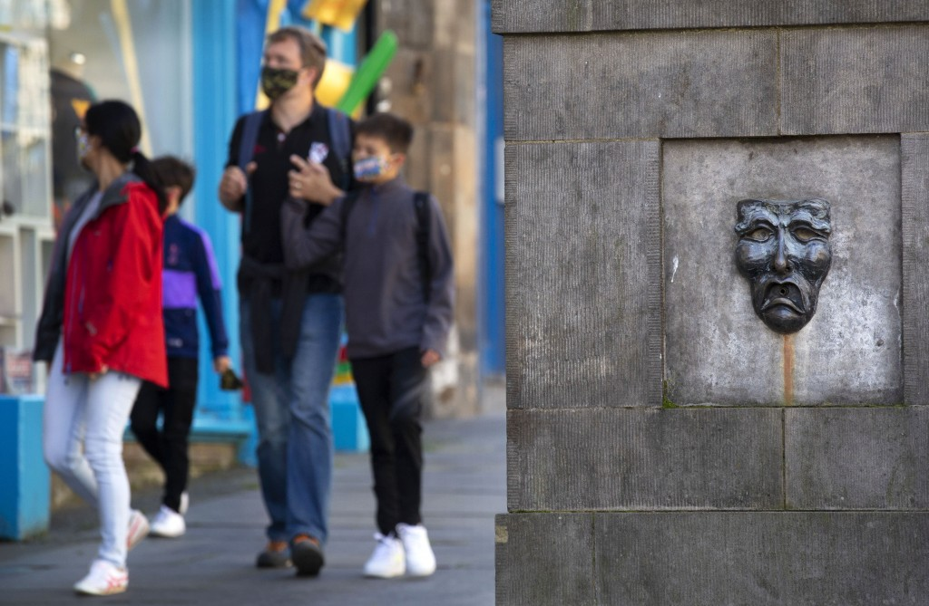 Tourists roam the normally busy Royal Mile in Edinburgh, Scotland, Friday Aug. 21, 2020.  One of the biggest casualties of the coronavirus has been th...