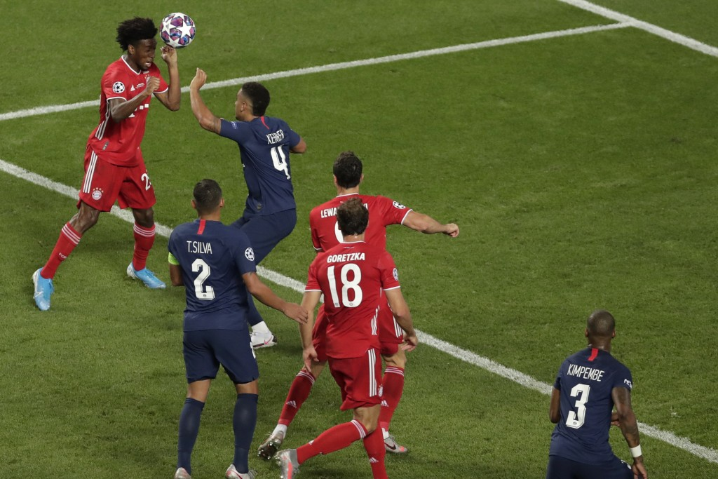 FILE - In this Sunday, Aug. 23, 2020 file photo, Bayern's Kingsley Coman scores his side's opening goal during the Champions League final soccer match...
