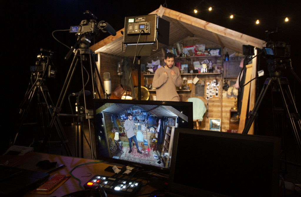 Performer Adam Kashmiry gets ready for his online performance at the Traverse theatre Edinburgh, Scotland, Friday Aug. 21, 2020. Edinburgh is renowned...