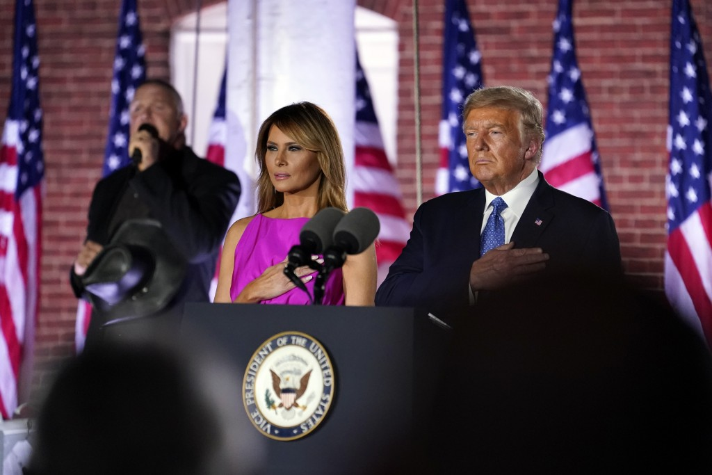 President Donald Trump and first Lady Melania Trump stand as Trace Adkins sings the National Anthem on the third day of the Republican National Conven...
