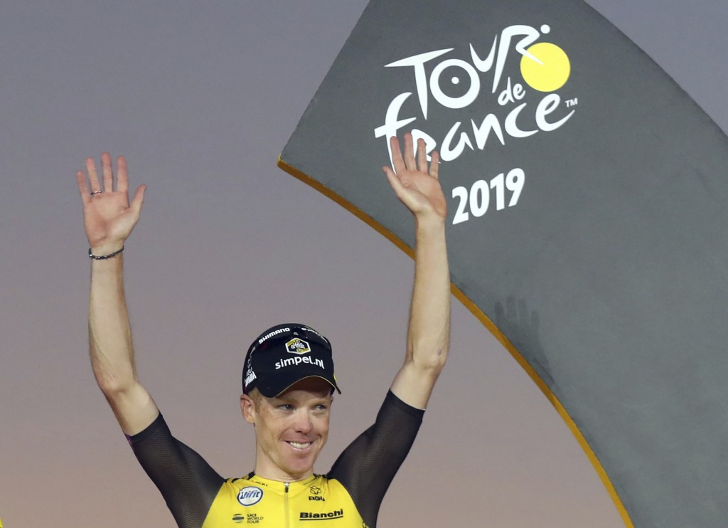 FILE - In this file photo dated Sunday, July 28, 2019, Netherlands' Steven Kruijswijk, celebrates third place, on the podium of the Tour de France cyc...