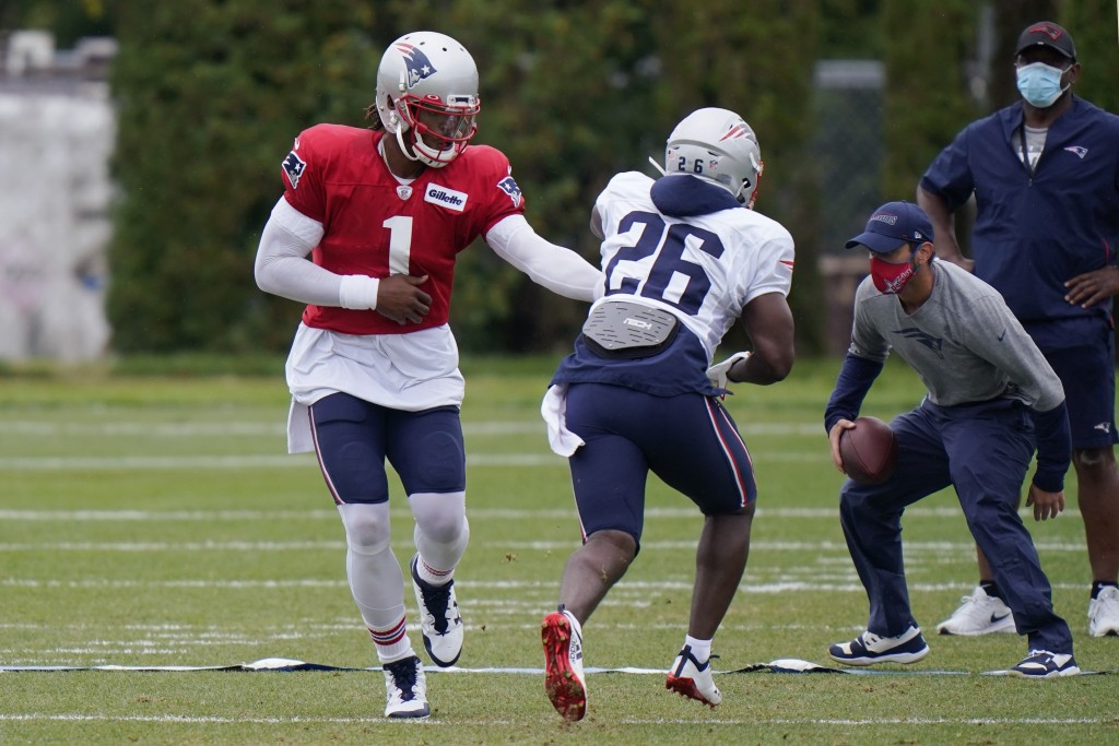 New England Patriots quarterback Cam Newton (1) hands off to running back Sony Michel (26) during an NFL football training camp practice, Thursday Aug...