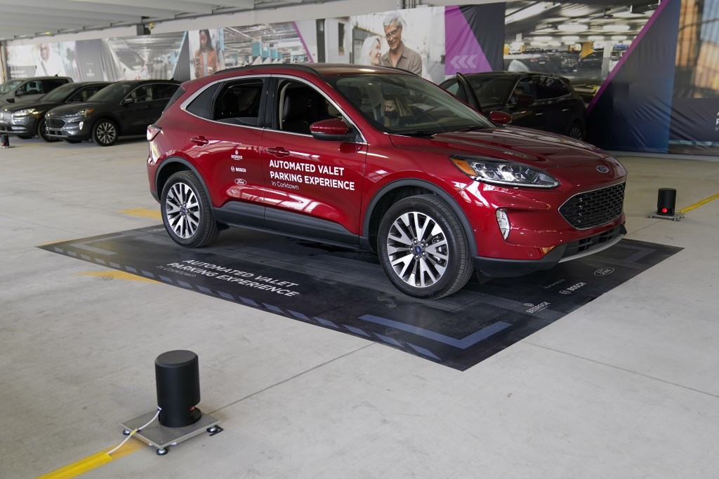A Ford Escape is seen on a starting block before floor sensors help navigate the vehicle to self park, Tuesday, Aug. 25, 2020 in Detroit. Ford, Bosch ...