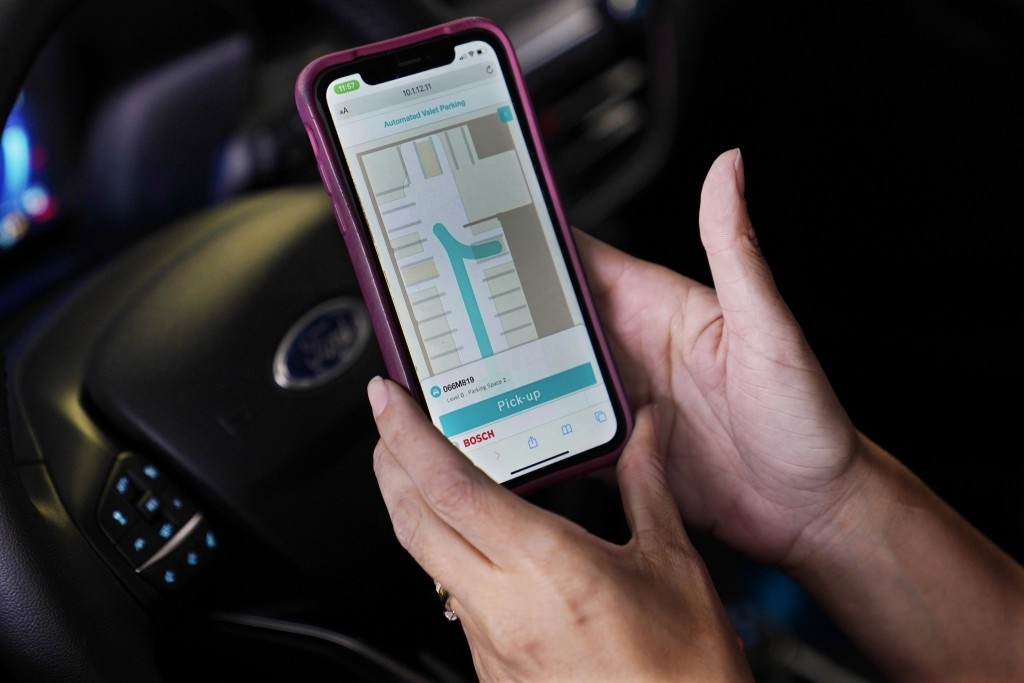A self parking app is shown by a test driver in a Ford Escape test vehicle during a demonstration of the vehicle's self parking feature, Tuesday, Aug....