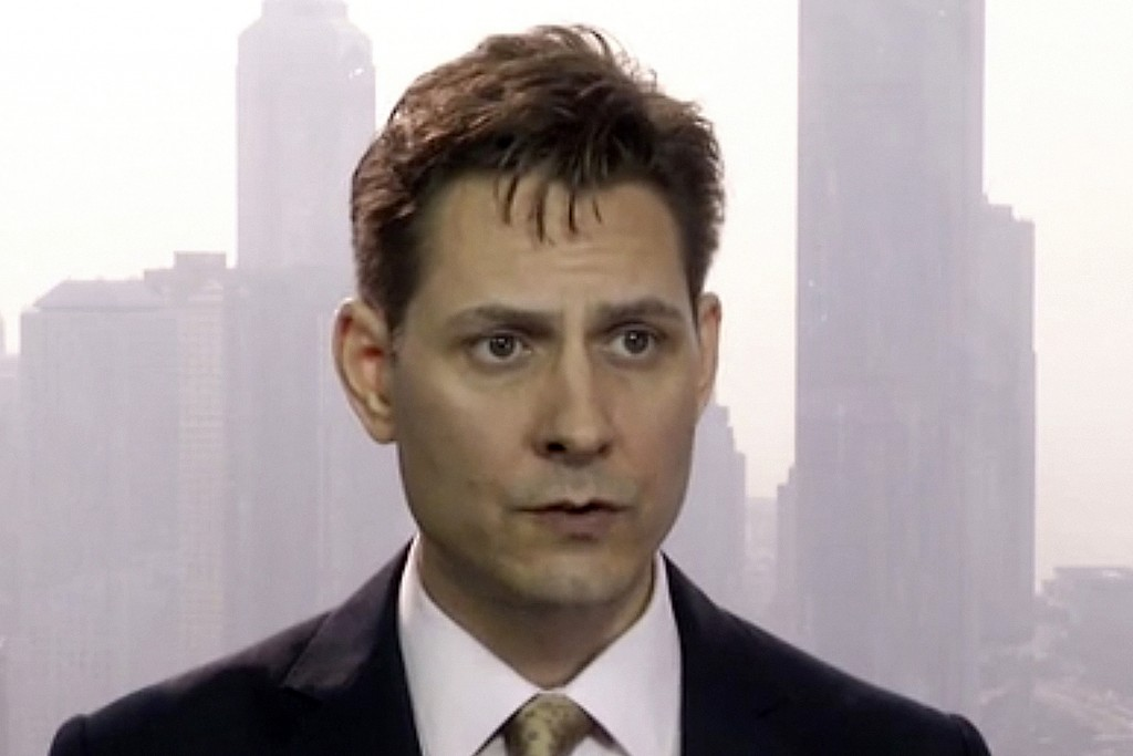 FILE - In this March 28, 2018, file image made from video, Michael Kovrig, an adviser with the International Crisis Group, a Brussels-based non-govern...