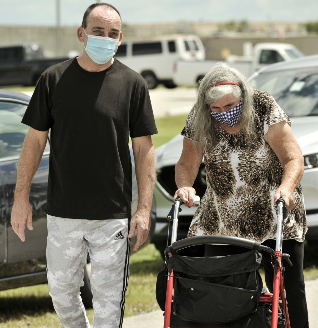 Former inmate Robert DuBoise, 56, walks with his mother Myra DuBoise outside the Hardee County Correctional Institute after serving 37 years in prison...