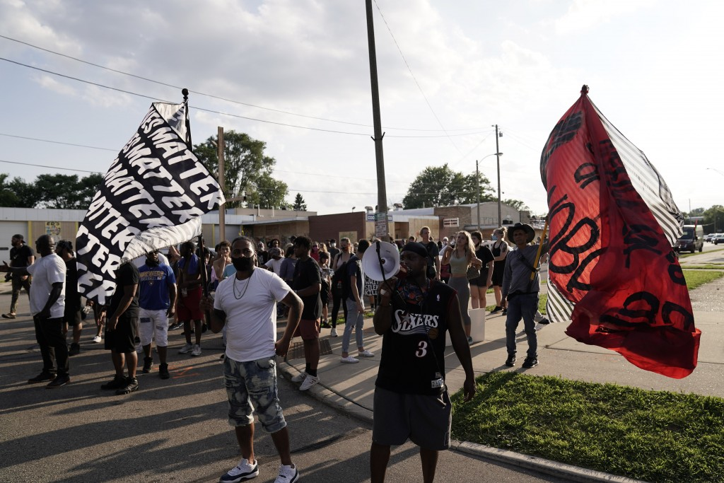 Protesters prepare to march against the Sunday police shooting of Jacob Blake Thursday, Aug. 27, 2020, in Kenosha, Wis. Until the police shooting of B...
