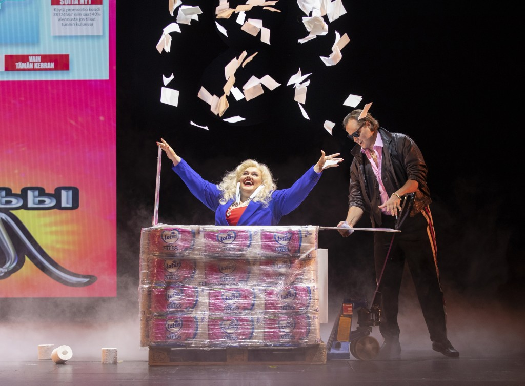 A singer at the Finnish National Opera performs the role of a greedy businessperson getting rich from the rush on toilet paper and face masks during a...