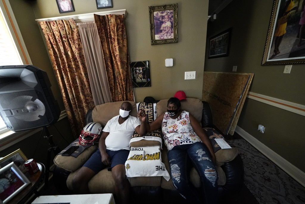 Mary and Barrett Duplessis pose for a photo in their home in New Orleans, Wednesday, Aug. 19, 2020. Levee breaches following Hurricane Katrina dumped ...