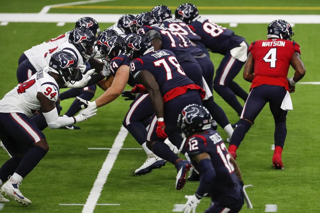 Houston Texans quarterback Deshaun Watson (4) runs a play during an NFL training camp football practice Thursday, Aug. 27, 2020, in Houston. (Brett Co...