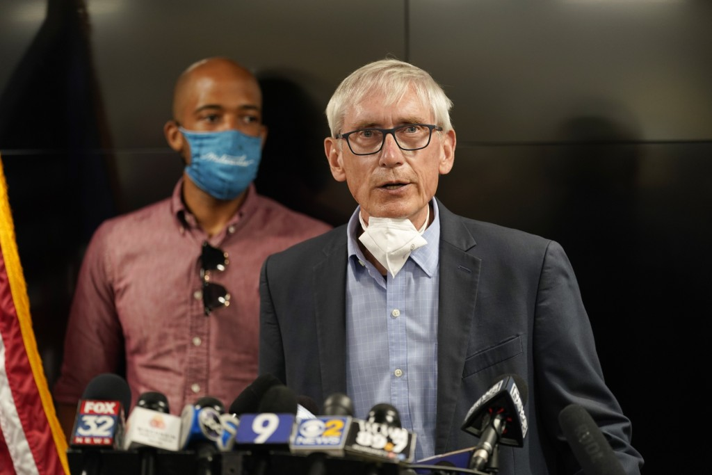 Wisconsin Governor Tony Evers speaks during a news conference Thursday, Aug. 27, 2020, in Kenosha, Wis. The city has suffered from unrest in the wake ...