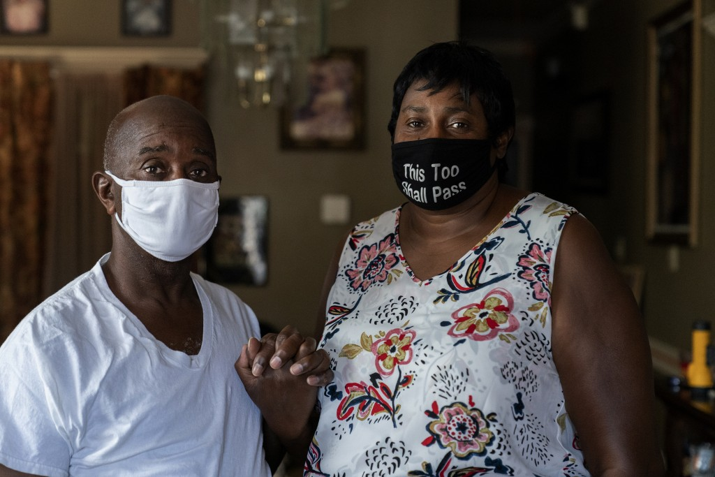 Mary and Barrett Duplessis pose for a portrait in their home in New Orleans, Wednesday, Aug. 19, 2020. Levee breaches following Hurricane Katrina dump...
