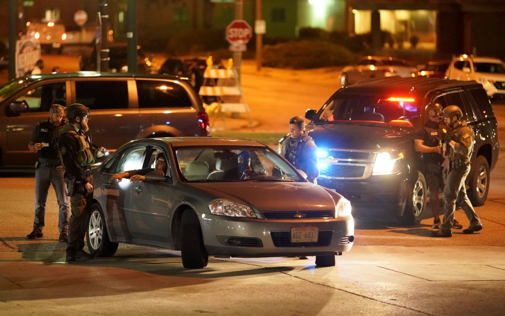 FILE - In this Aug. 26, 2020 file photo, police stop a car near where protesters gather for a fourth night to demonstrate against the police violence ...
