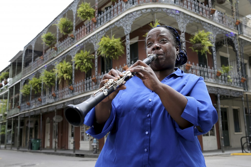Musician Doreen Ketchens plays her clarinet at the corner of St. Peter and Royal streets in the French Quarter of New Orleans, Wednesday, Aug. 26, 202...