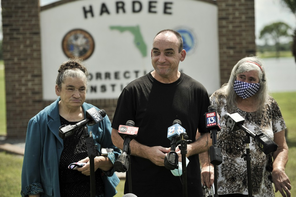 Former inmate Robert DuBoise, 56, meets reporters with his sister Harriet, left, and mother Myra, right, outside the Hardee County Correctional Instit...