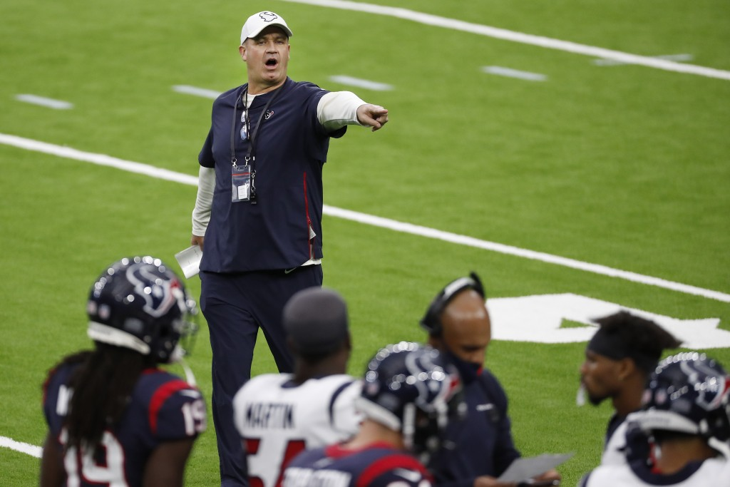 Houston Texans head coach Bill O'Brien calls directions to his players during an NFL training camp football practice Thursday, Aug. 27, 2020, in Houst...