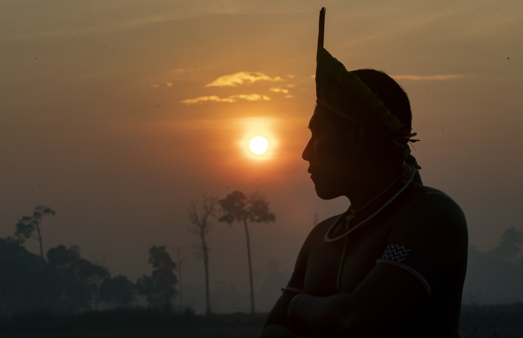 A Kayapo Indigenous man joins a protest at sunrise to block highway BR-163 near Novo Progresso, Para state, Brazil, Monday, Aug. 17, 2020. The protest...