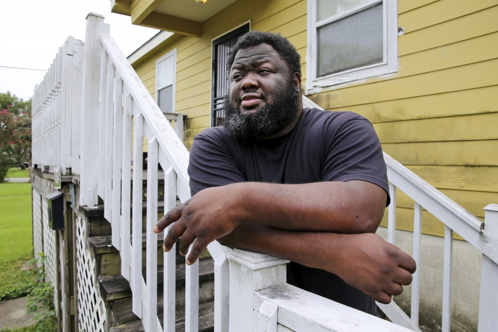 Shaun Mills, who is currently furloughed from his job due to COVID-19, stands in front of his home in New Orleans, Wednesday, Aug. 26, 2020. Even befo...