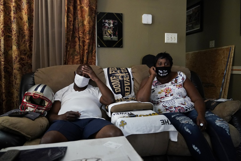 Mary and Barrett Duplessis speak during an interview with The Associated Press in their home in New Orleans, Wednesday, Aug. 19, 2020. Levee breaches ...