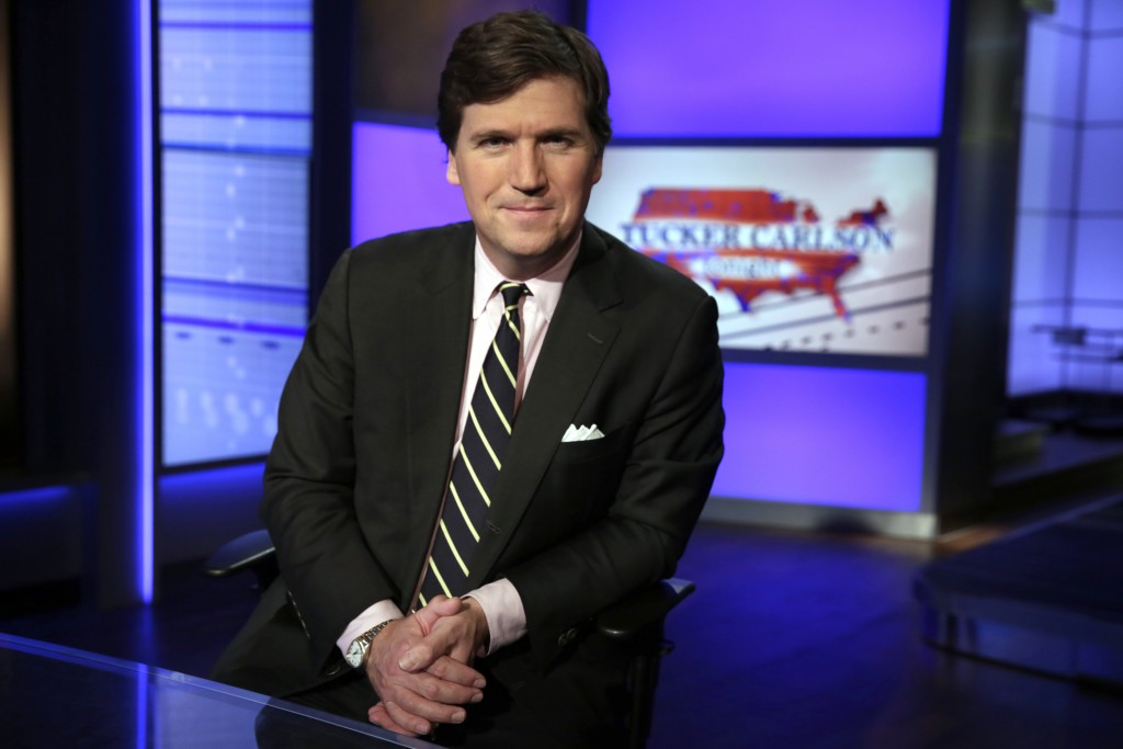 """FILE - Tucker Carlson, host of """"Tucker Carlson Tonight,"""" poses for photos in a Fox News Channel studio Thursday, March 2, 2107 in New York. Carlson sa..."""