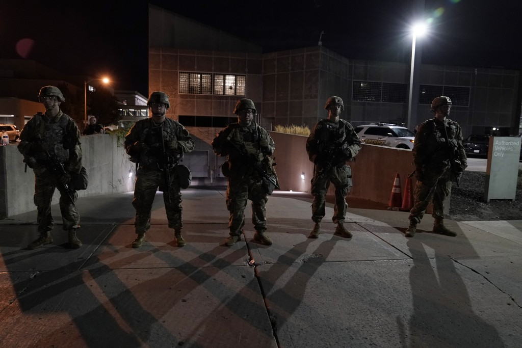 The National Guard protect the perimeter of government buildings in Kenosha, Wis. on Thursday, Aug. 27, 2020. People gathered for the fifth night to p...