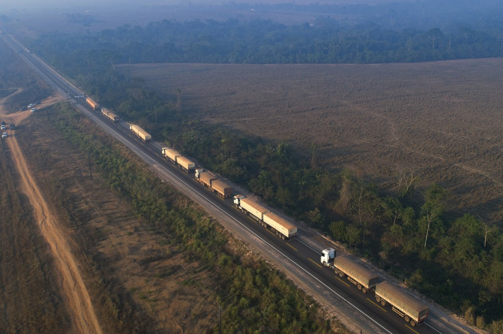 Trucks sit idle on highway BR-163 as it is blocked by Kayapo Indigenous near Novo Progresso, Para state, Brazil, Monday, Aug. 17, 2020. Protesters blo...