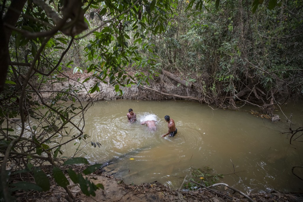 Kayapo men bathe in a river during a pause in their blocking Highway BR-163 near Novo Progresso, Para state, Brazil, Wednesday, Aug. 19, 2020. Indigen...