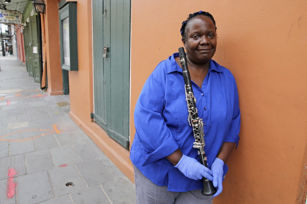 Musician Doreen Ketchens leans against a wall on an empty St. Peter Street in the French Quarter of New Orleans, Wednesday, Aug. 26, 2020. For Ketchen...