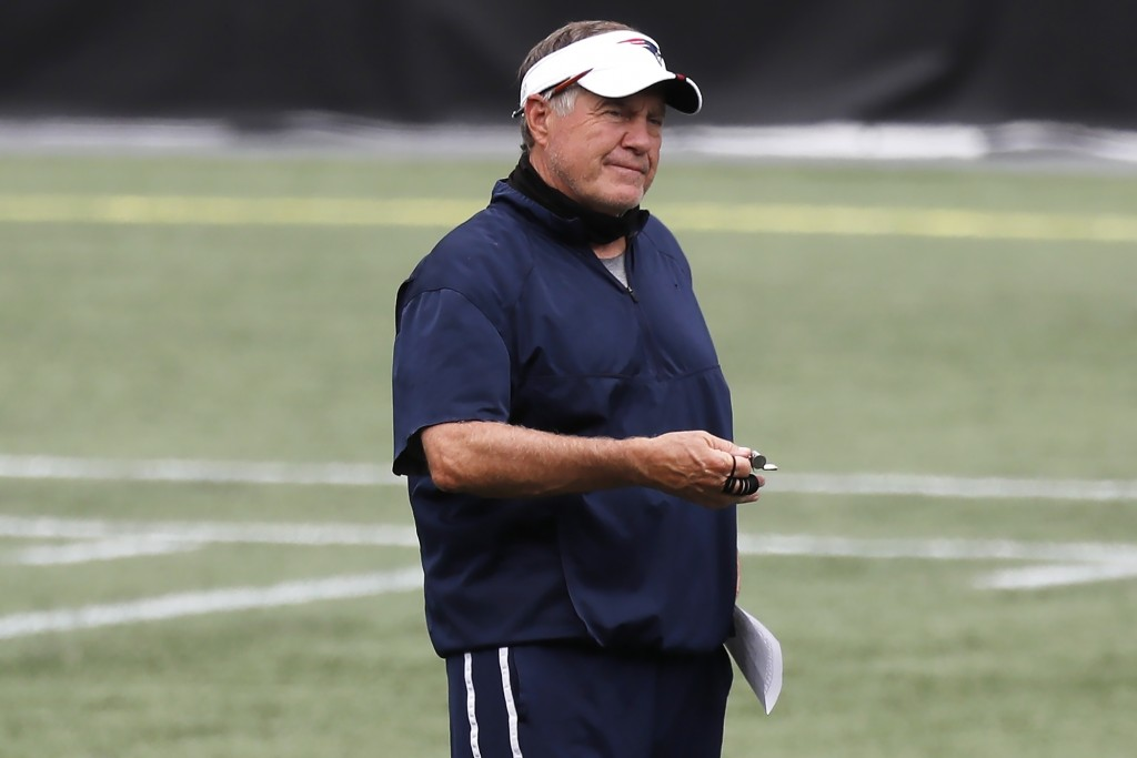 New England Patriots head coach Bill Belichick stands on the field before an NFL football training camp scrimmage, Friday, Aug. 28, 2020, in Foxboroug...