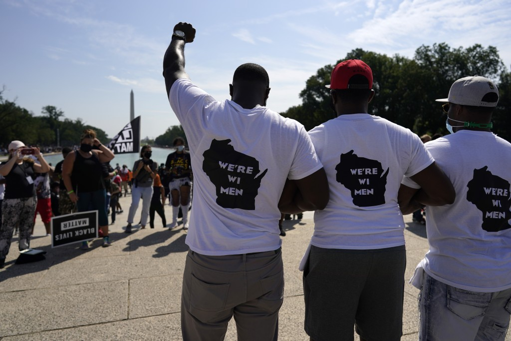 "Men from Milwaukee wear ""We're WI Men"" T-shirts as they attend the March on Washington, Friday Aug. 28, 2020, in Washington, on the 57th anniversary o..."