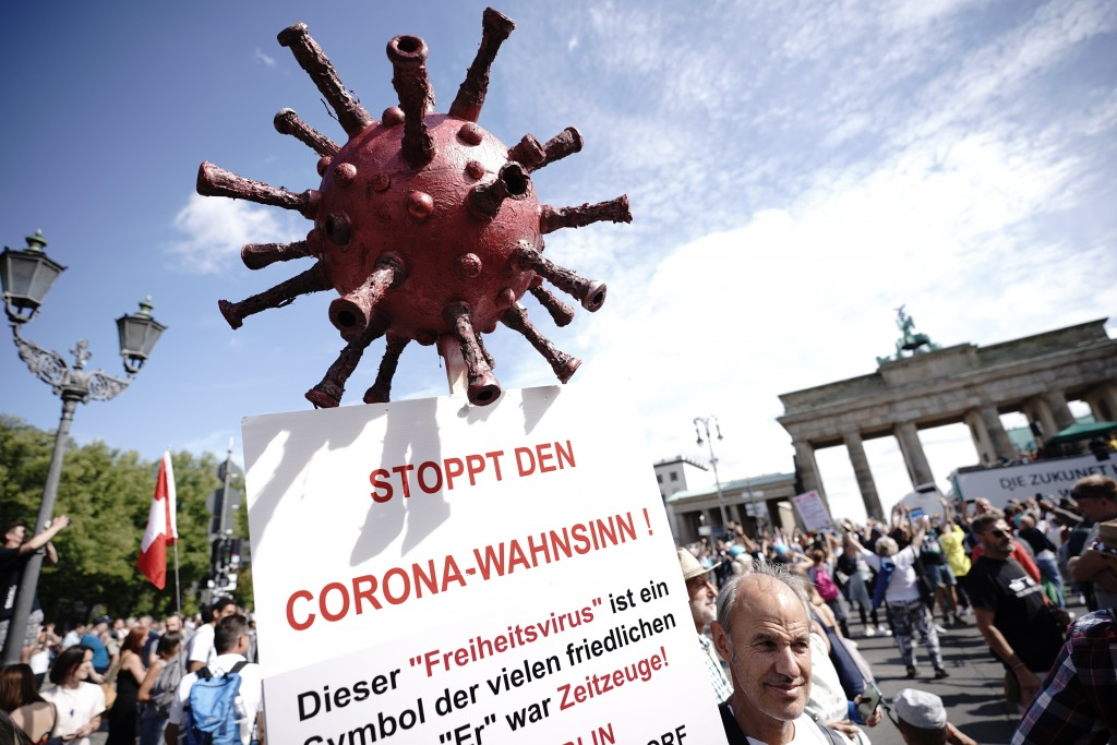 "A protestor holds a sign reading ""Stop the Corona Madness!"" during demonstrations against the coronavirus measures by the German Government in Berlin,..."