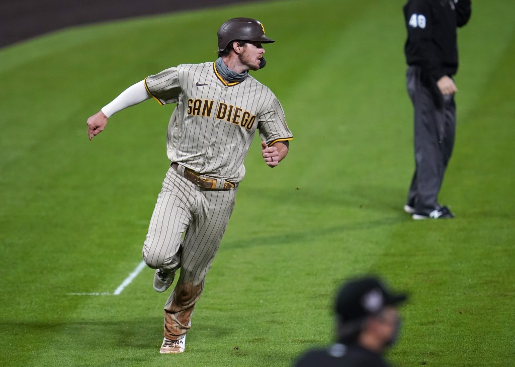 San Diego Padres' Wil Myers scores on a single hit by Ty France off Colorado Rockies starting pitcher Kyle Freeland in the fifth inning of a baseball ...