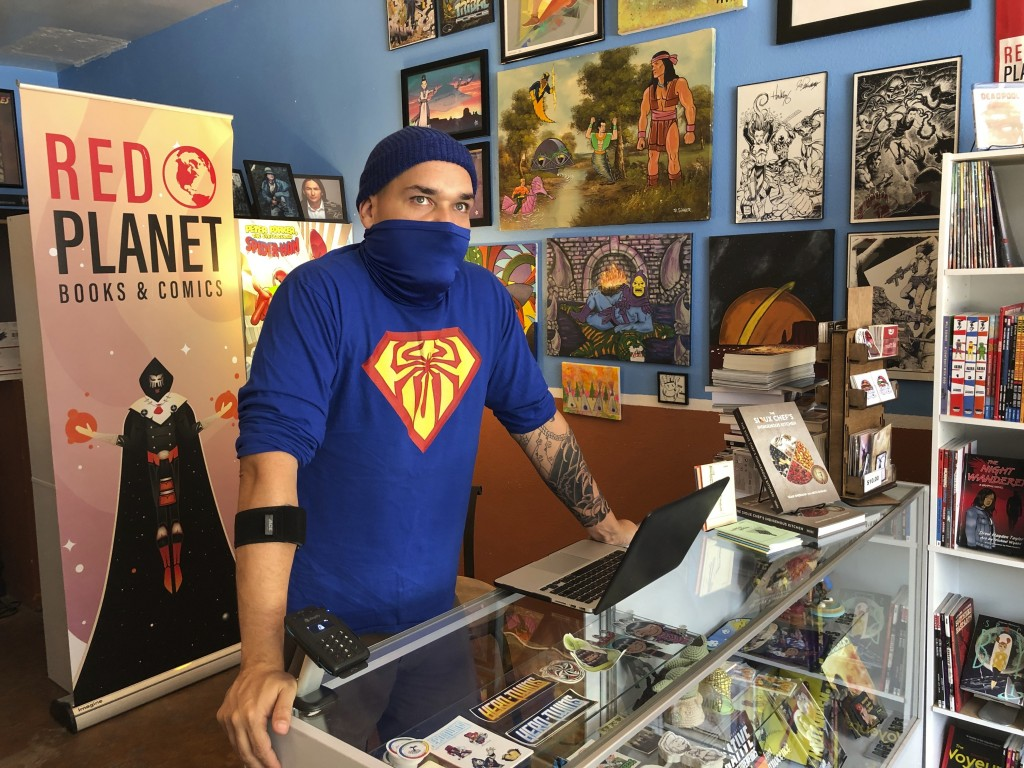 This Aug. 19, 2020, image shows Aaron Cuffee of Red Planet Books & Comics in Albuquerque, N.M., as he discusses the potential that could come from Mar...