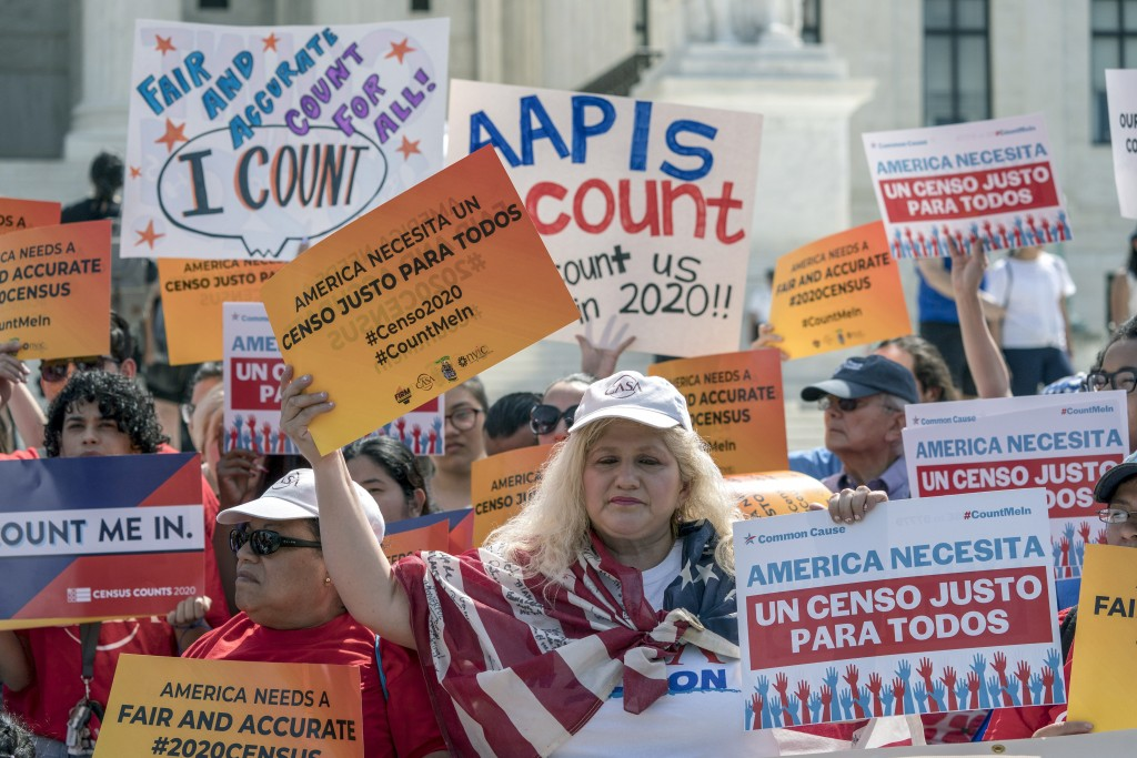 FILE - In this April 23, 2019 file photo, immigration activists rally outside the Supreme Court as the justices hear arguments over the Trump administ...