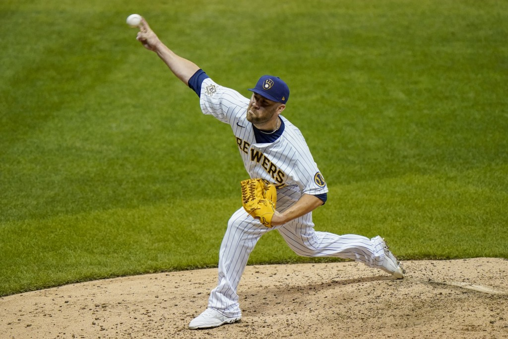 Milwaukee Brewers relief pitcher David Phelps throws during the seventh inning of a baseball game against the Pittsburgh Pirates Friday, Aug. 28, 2020...