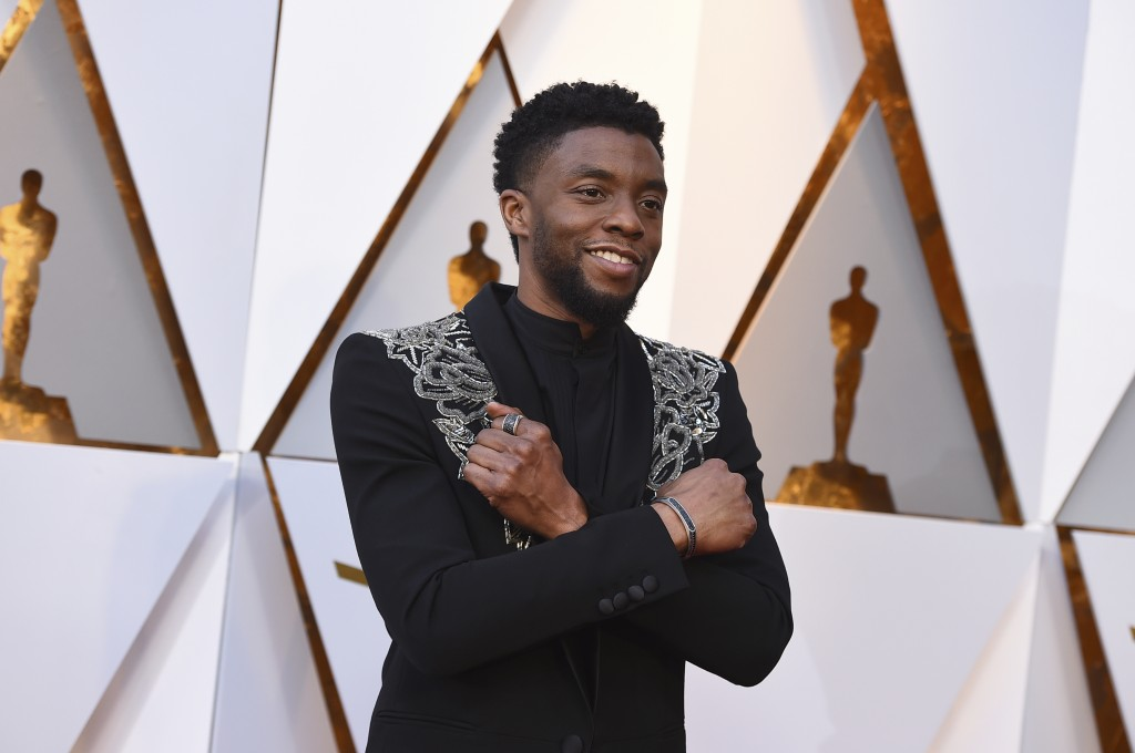 FILE - In this March 4, 2018 file photo, Chadwick Boseman arrives at the Oscars at the Dolby Theatre in Los Angeles.   Actor Chadwick Boseman, who pla...