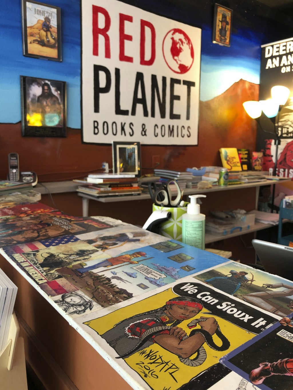 This Aug. 19, 2020, image shows some of the art that decorates the counters and walls at Red Planet Books & Comics in Albuquerque, N.M. Marvel Comics ...