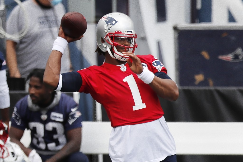 New England Patriots quarterback Cam Newton (1) warms up before an NFL football training camp scrimmage, Friday, Aug. 28, 2020, in Foxborough, Mass. (...