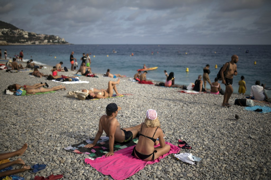 Tourists enjoy the beach in Nice, southern France, Friday, Aug 28, 2020. The Tour de France sets off shrouded in uncertainty in the face of the corona...