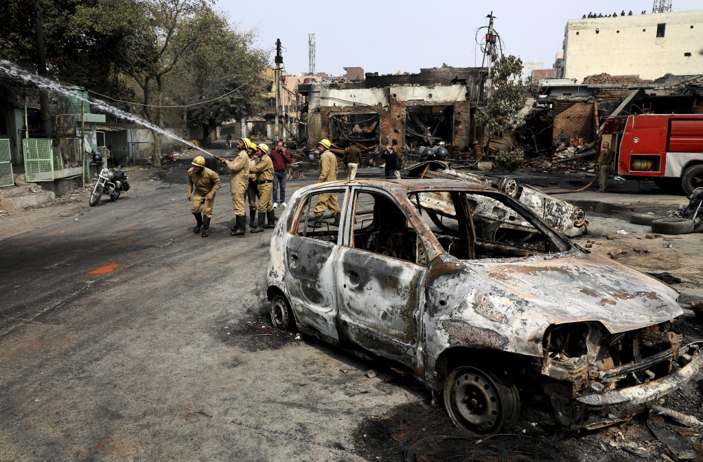FILE - In this Wednesday, Feb. 26, 2020, file photo, firefighters douse a fire at Gokul puri tyre market which was burnt Tuesday in New Delhi, India. ...
