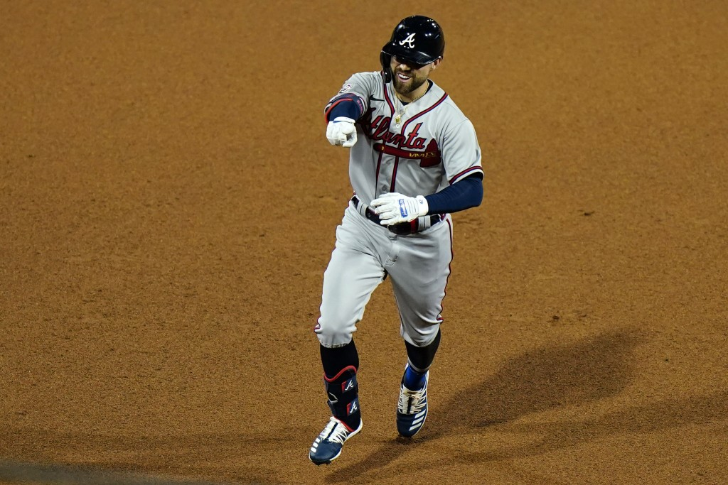 Atlanta Braves' Ender Inciarte reacts as he rounds the bases after hitting a home run off Philadelphia Phillies pitcher Adam Morganduring the seventh ...