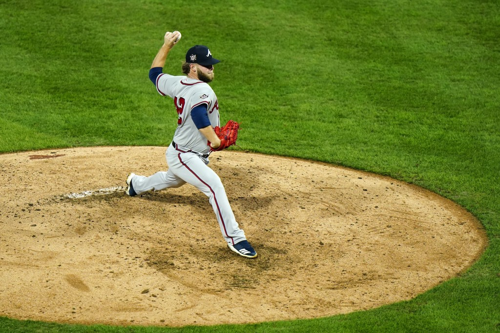 Atlanta Braves' A.J. Minter pitches during the sixth inning of a baseball game against the Philadelphia Phillies, Friday, Aug. 28, 2020, in Philadelph...