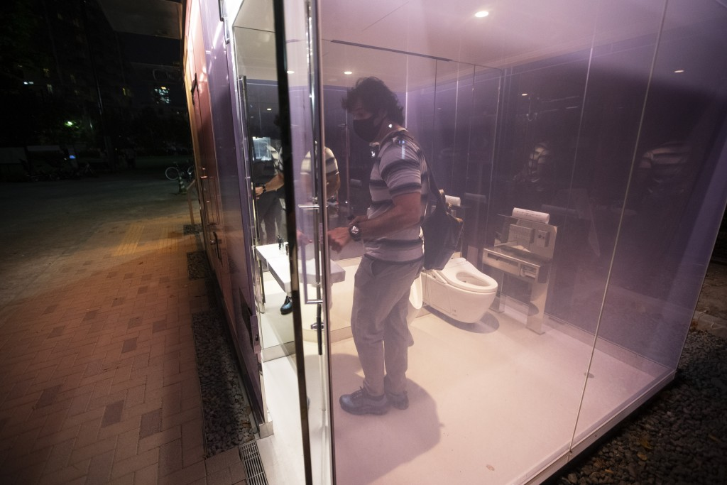 Nasser Najafian, of Tehran, Iran, working in Tokyo, gets out of a transparent glass toilet after use, at Yoyogi Hukamachi Mini Park in Tokyo on Thursd...