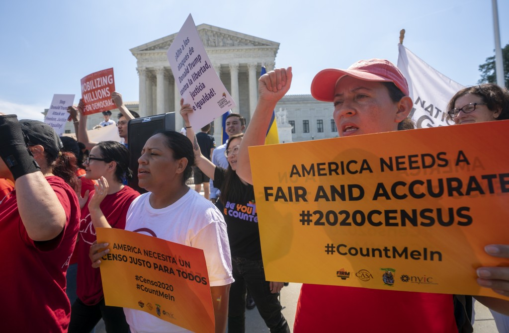 FILE In this June 27, 2019, file photo, demonstrators gather at the Supreme Court as the justices finish the term with key decisions on gerrymandering...