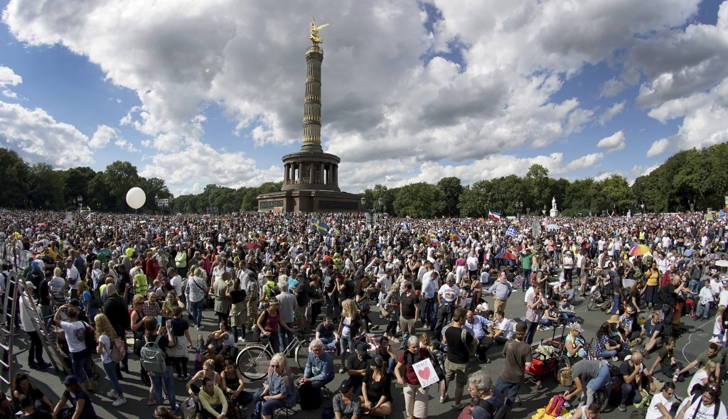People gather at the Victory Column as they attend a protest rally in Berlin, Germany, Saturday, Aug. 29, 2020 against new coronavirus restrictions in...