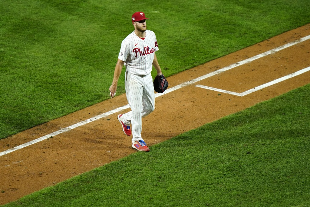 Philadelphia Phillies pitcher Zack Wheeler walks off the field after being pulled during the sixth inning of a baseball game against the Atlanta Brave...