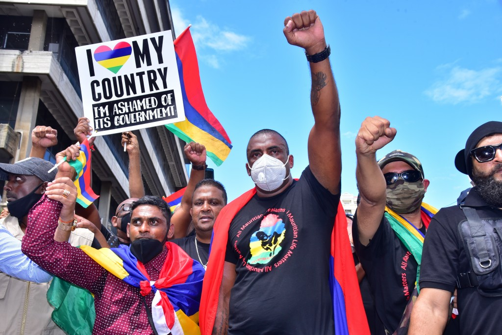 Tens of thousands of people protest in Port Louis, Mauritius, Saturday Aug. 29, 2020, over the government's slow response to an oil spill from a groun...