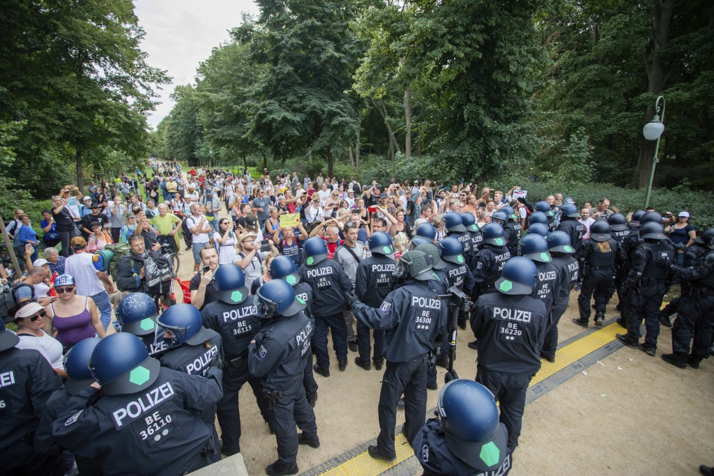 Policemen push people into the Tiergarten in a protest against the Corona measures in Berlin, Germany, Sunday, Aug. 30, 2020 (Christoph Soeder/dpa via...