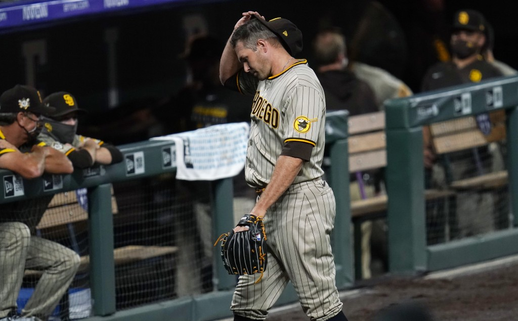San Diego Padres relief pitcher Craig Stammen heads to the dugout after giving up a walkoff RBI-single to Colorado Rockies pinch-hitter Daniel Murphy ...